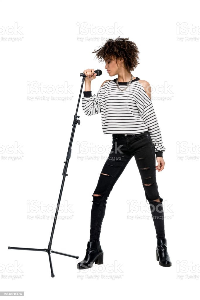 african american young woman singing with microphone isolated on white, rock and roll girl concept stock photo