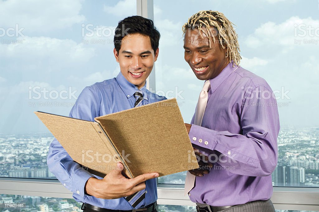 African and Asian managers royalty-free stock photo