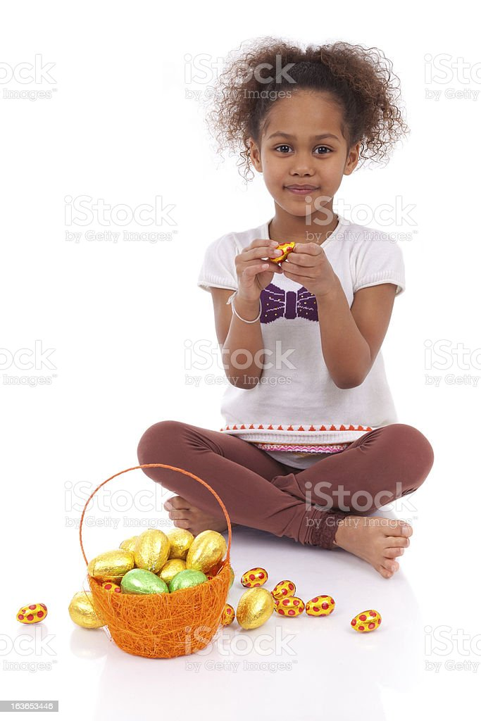 African Asian girl holding chocolate ester egg royalty-free stock photo