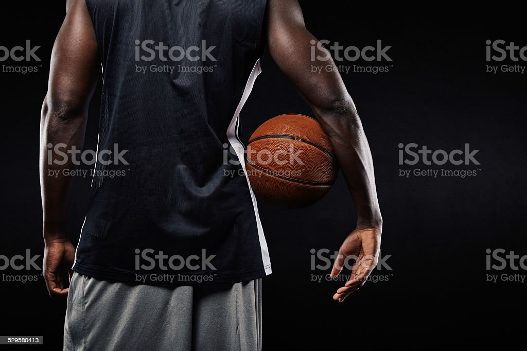 African basketball player with a ball in his arm stock photo