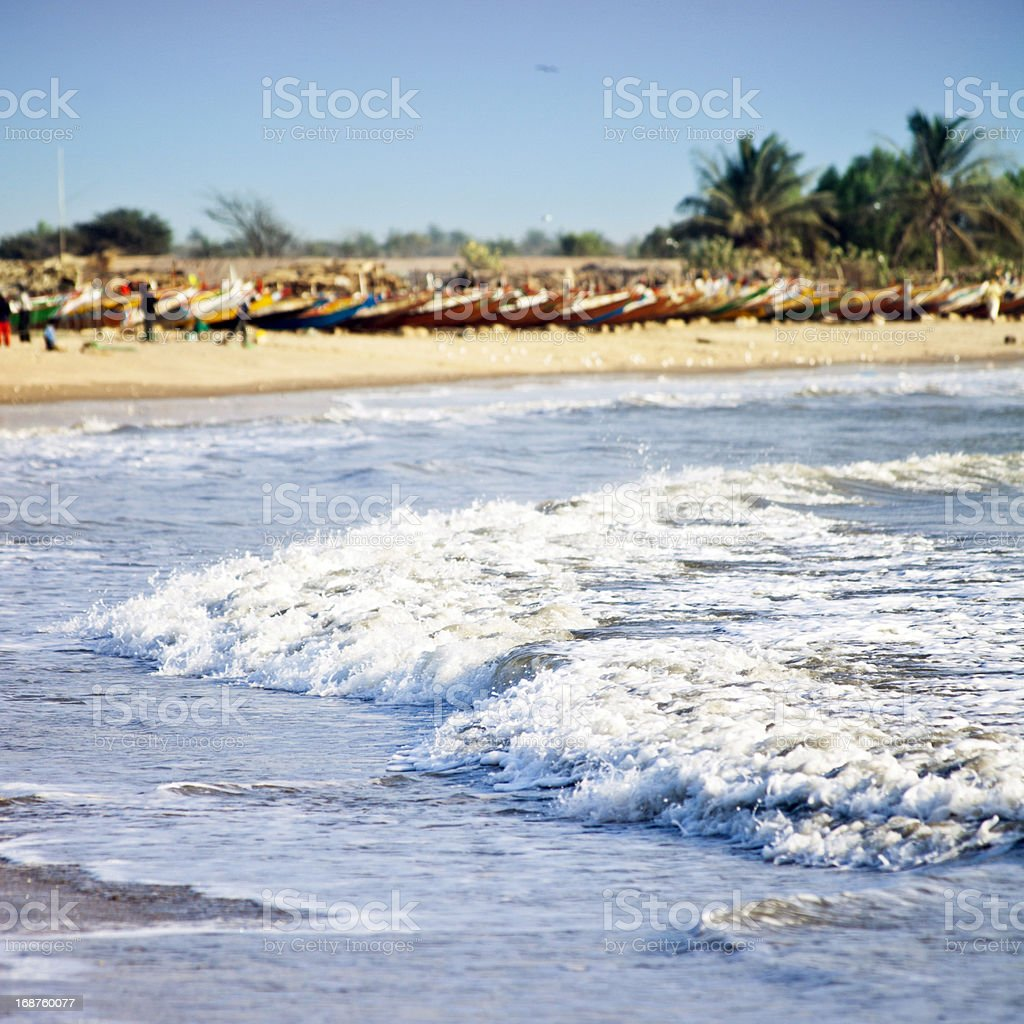 African beach scene with fishing boats stock photo