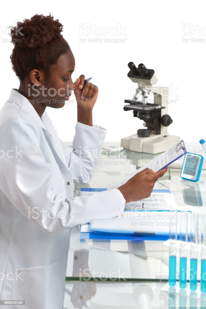 African biologist, medical student or doctor works in the office stock photo