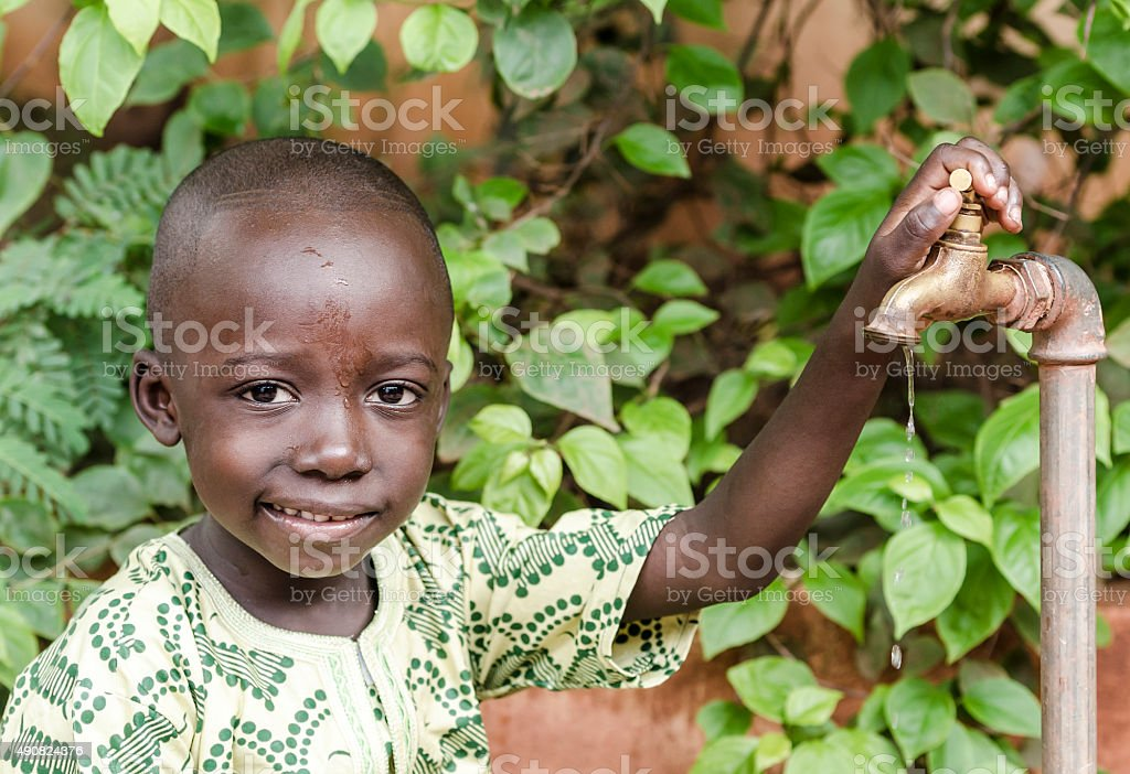 African Black Boy Smiling for Fresh Clean Water stock photo