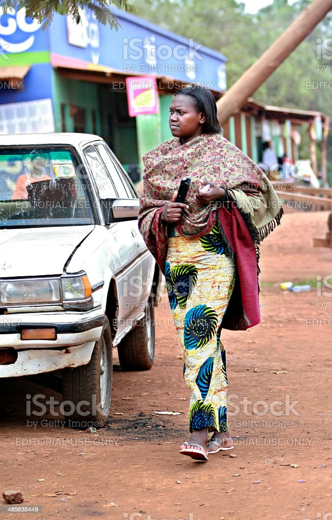 African black woman dressed in ponchos and colorful dress stock photo