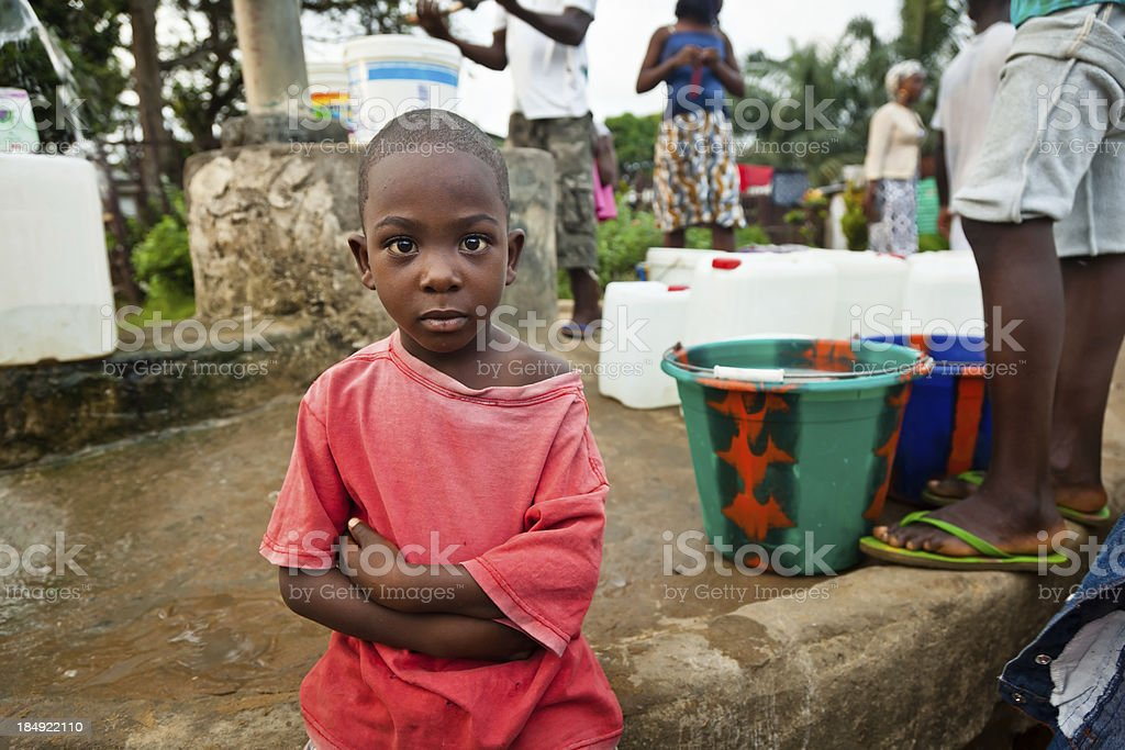 African Boy By Water Pump royalty-free stock photo