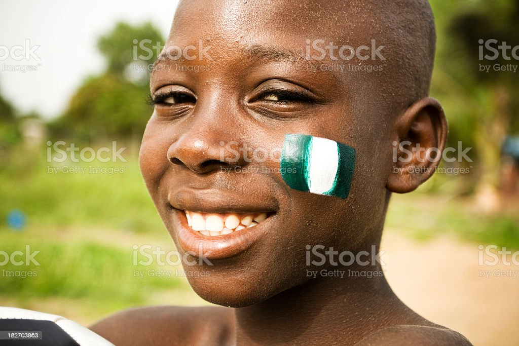 African boy with flag of Nigeria on a cheek royalty-free stock photo