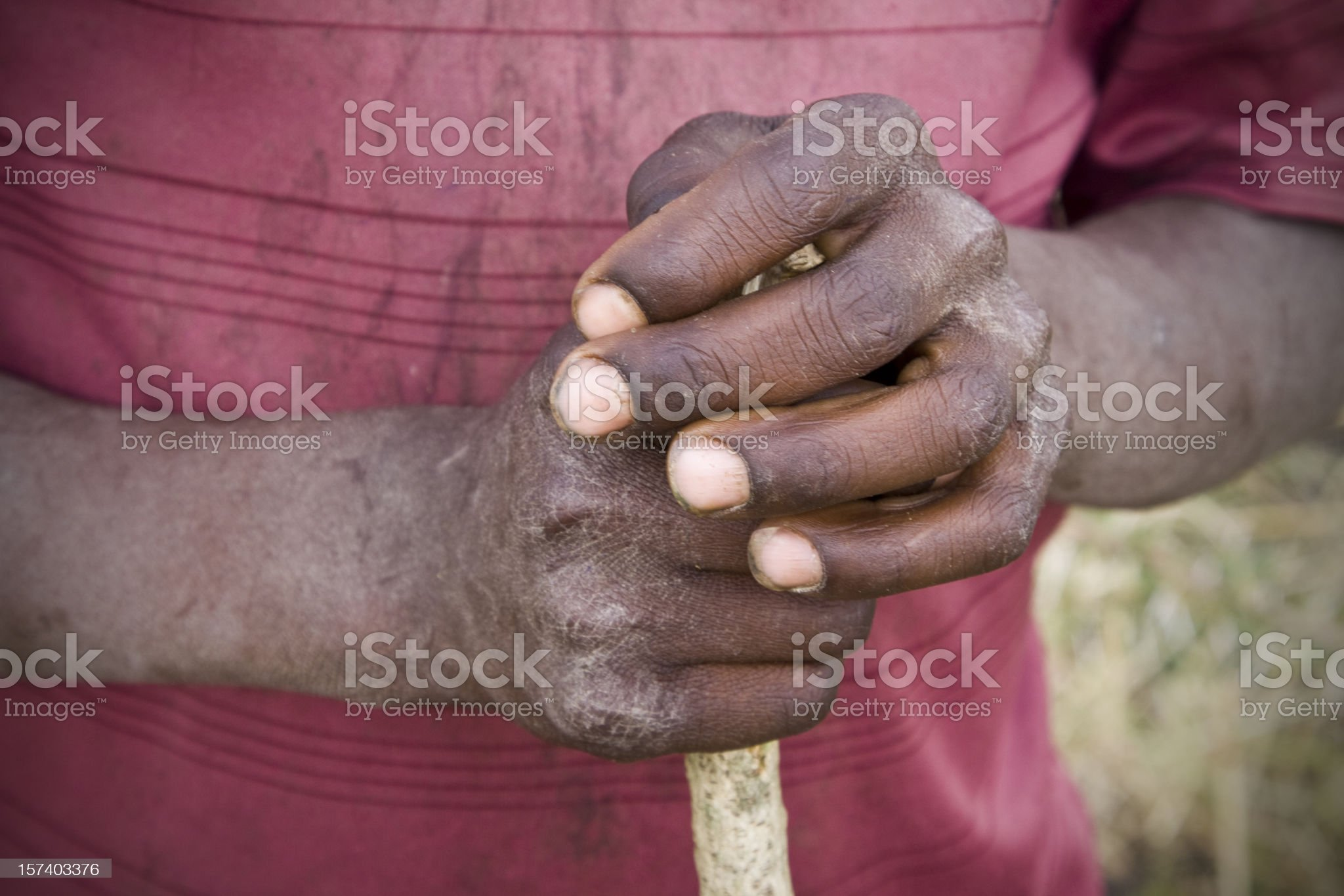 African boy's hands holding stick royalty-free stock photo
