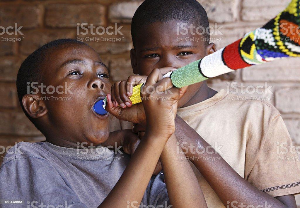 African boys with Vuvuzela stock photo