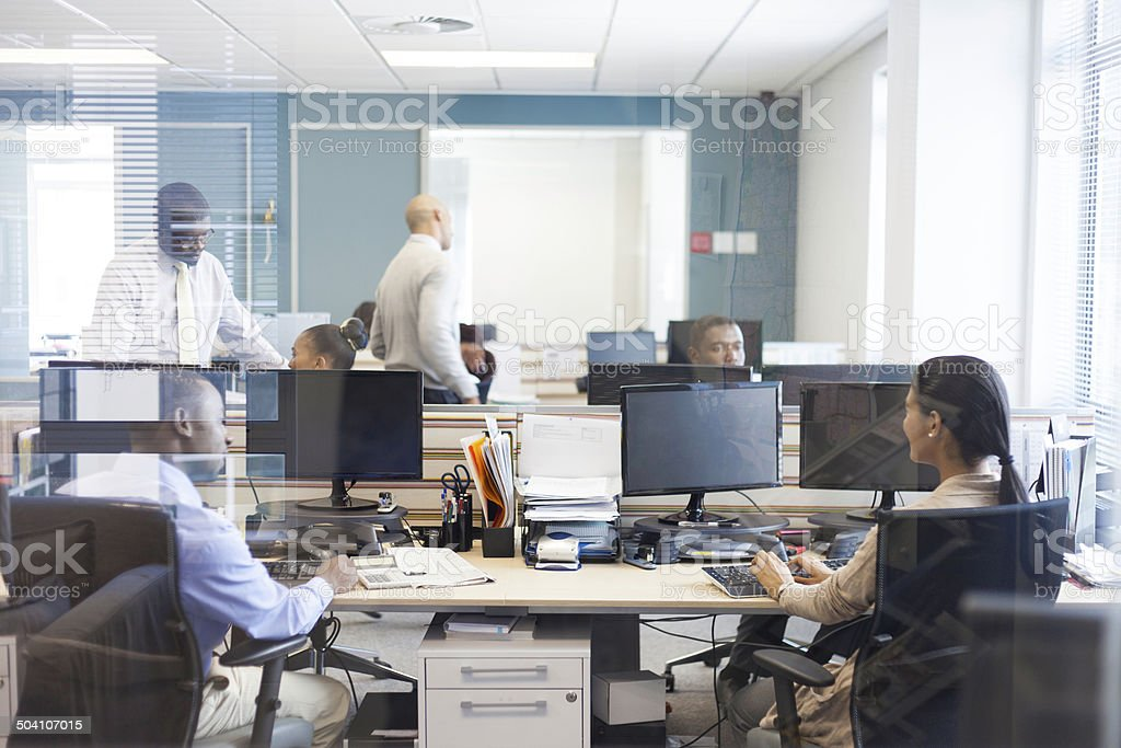 African business firm doing their jobs. stock photo