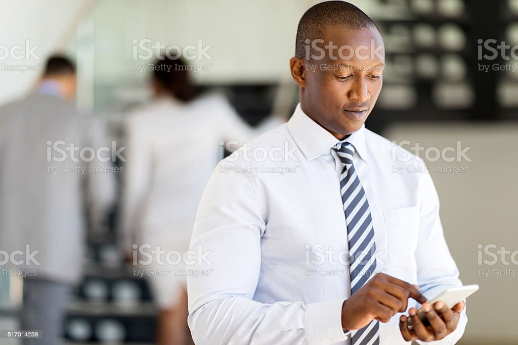 african business man using smart phone stock photo