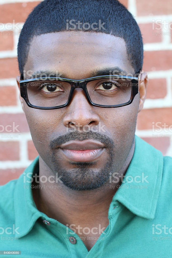 African business man with glasses looking serious stock photo
