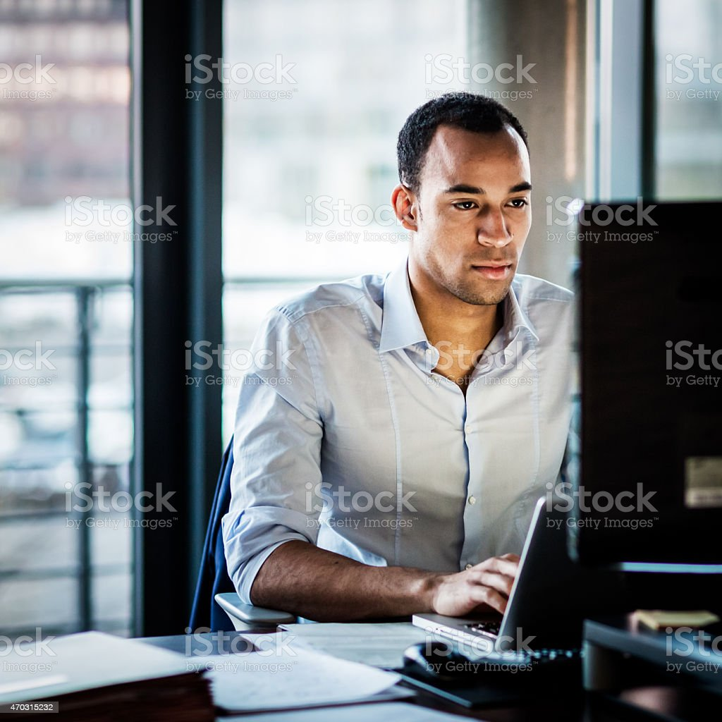 African Business Man Working Late stock photo