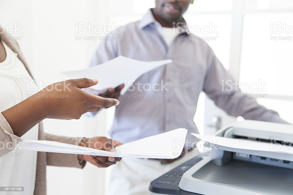 African Business Partners making copies on the printing machine. stock photo