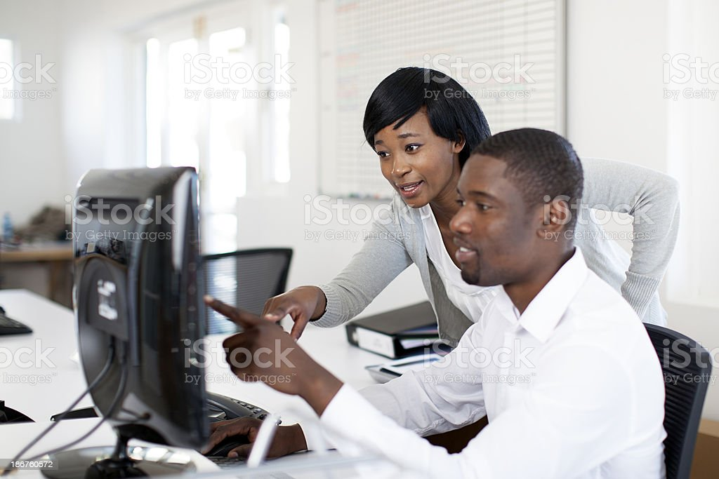 African business partners reading emails together. royalty-free stock photo