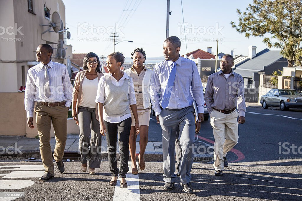African business team crossing the street stock photo