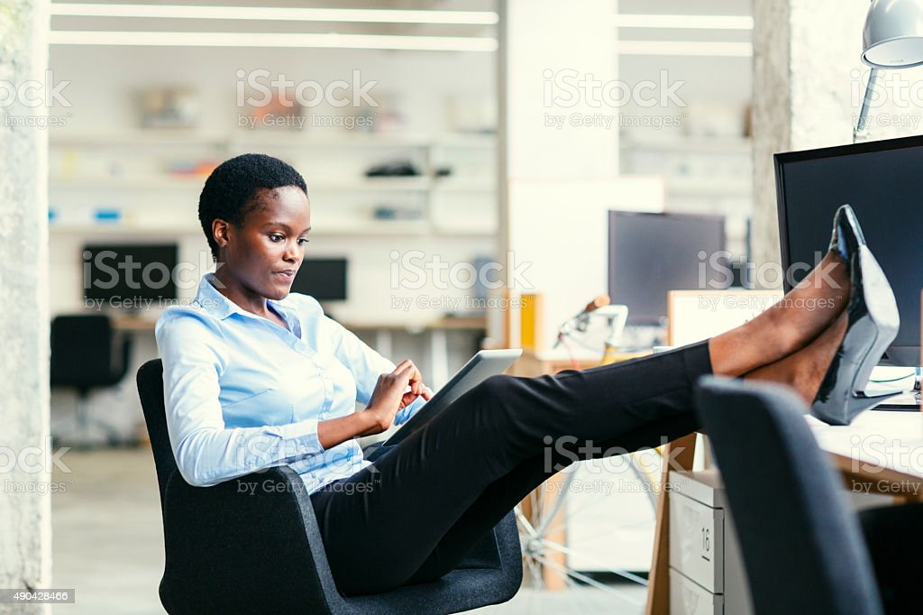 African Business Woman On Coffee Break. stock photo