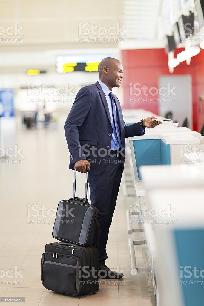 african businessman by airport check in counter royalty-free stock photo