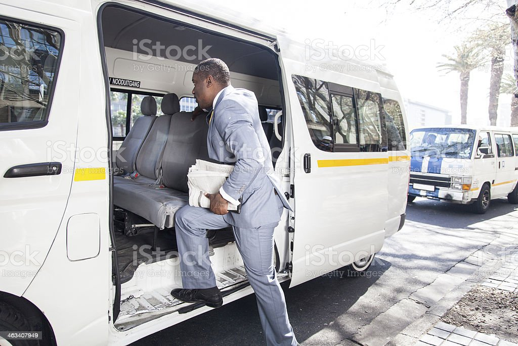African businessman getting in a taxi stock photo