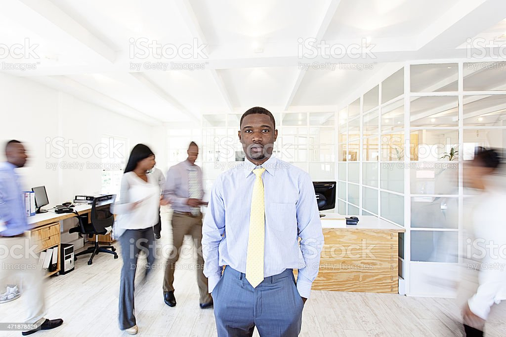 African businessman in the middle of his busy office royalty-free stock photo