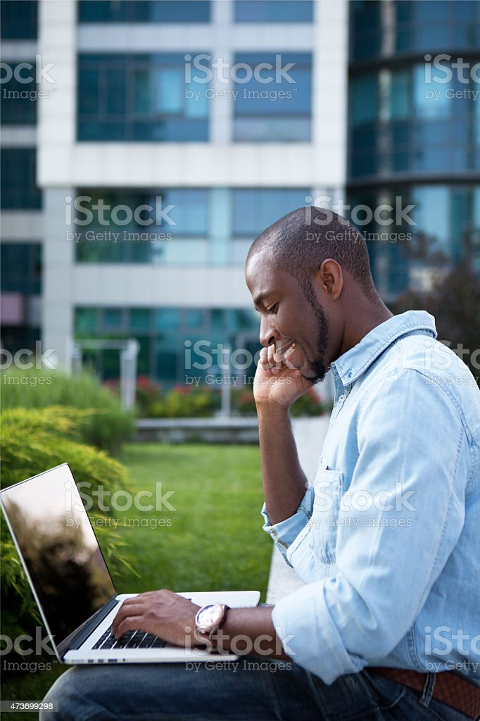 African businessman outside office building stock photo