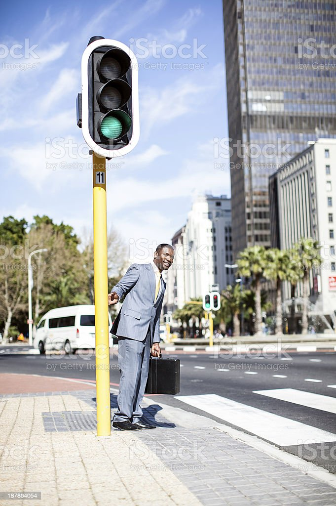 African businessman preparing to cross the road. royalty-free stock photo