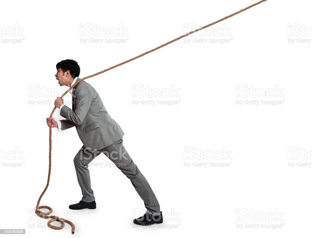 African businessman pulling a rope on white background stock photo