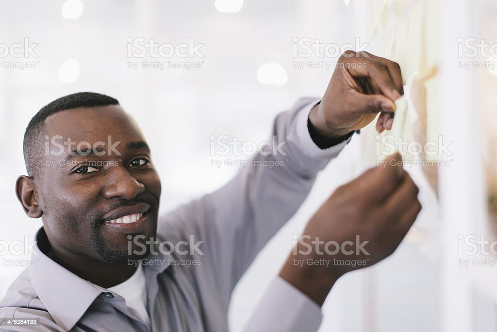 African Businessman Sticking Post Its. royalty-free stock photo