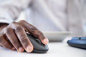 African businessman using Computer Mouse