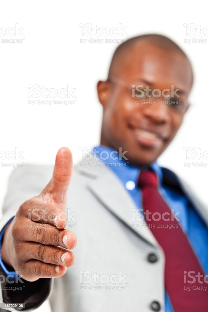 African businessman welocomes you aboard stock photo