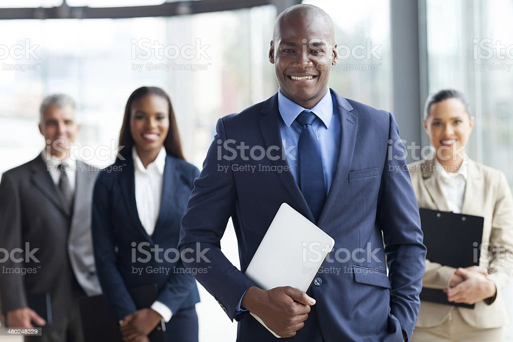 african businessman with group of businesspeople stock photo