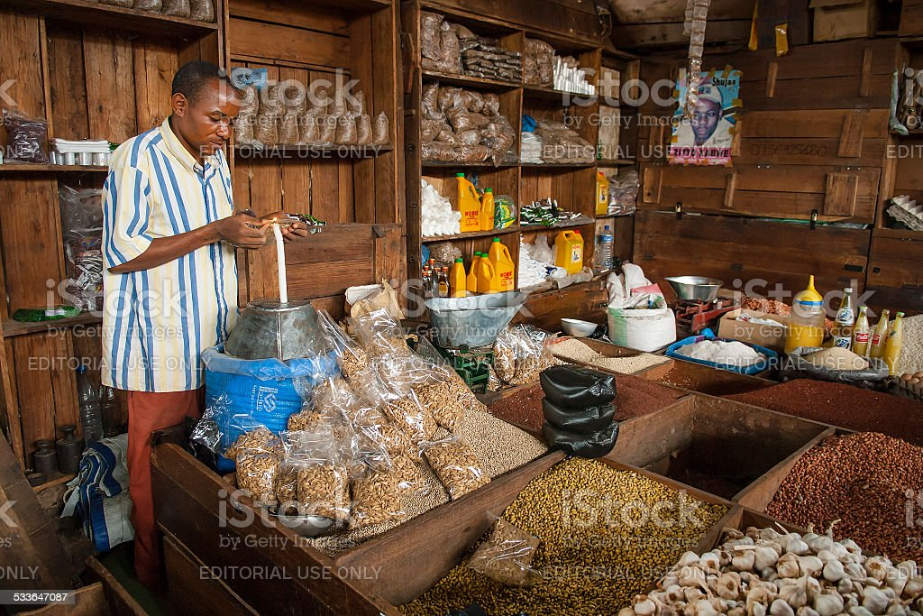 African businessman working in his food shop stock photo
