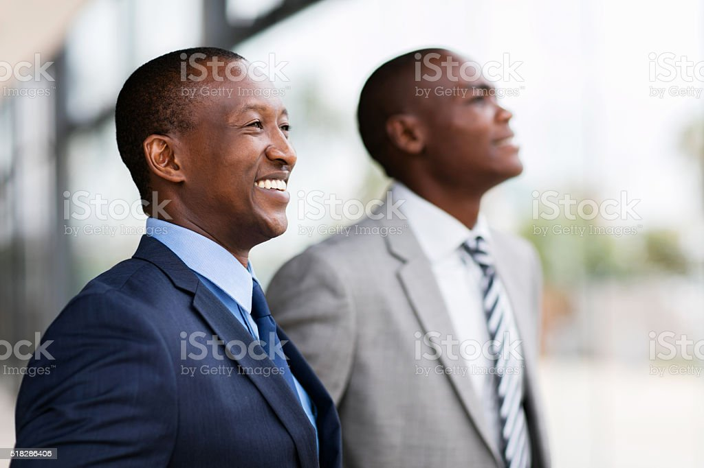 african businesspeople looking away stock photo