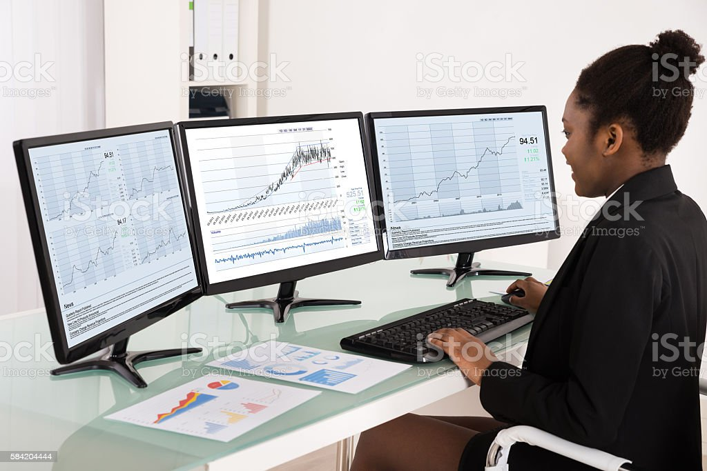 African Businesswoman Analyzing Data stock photo