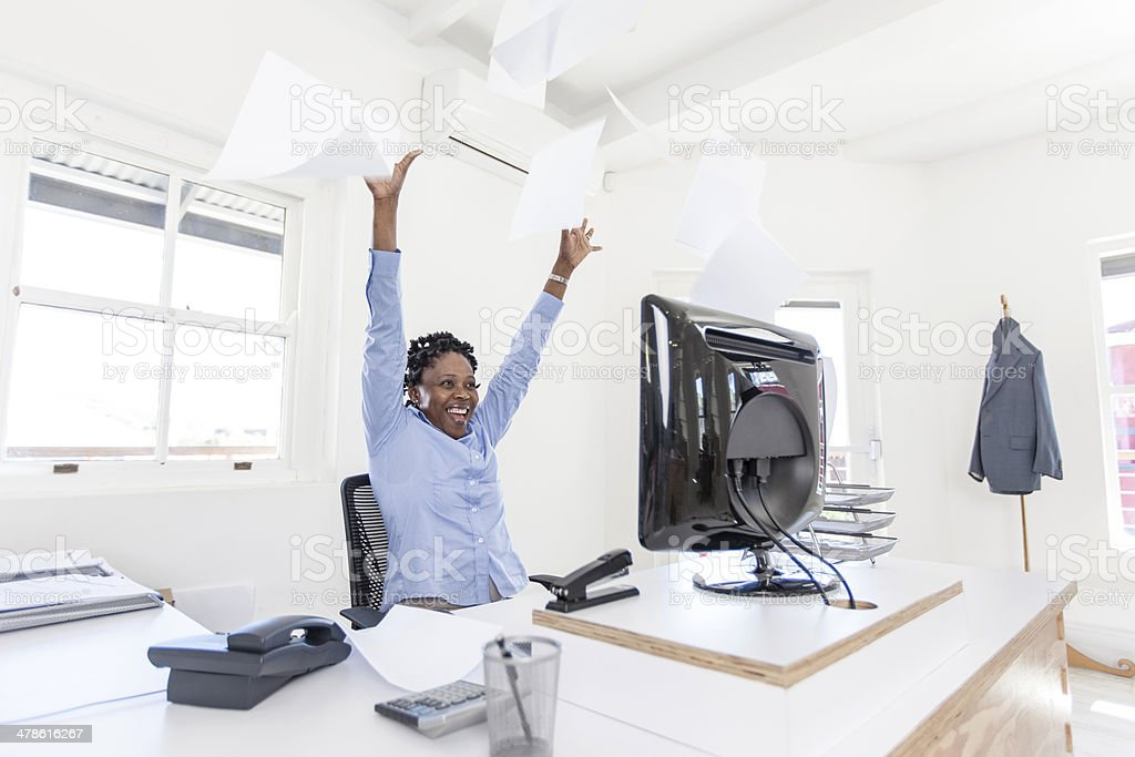 African businesswoman celebrating the new job she just found stock photo