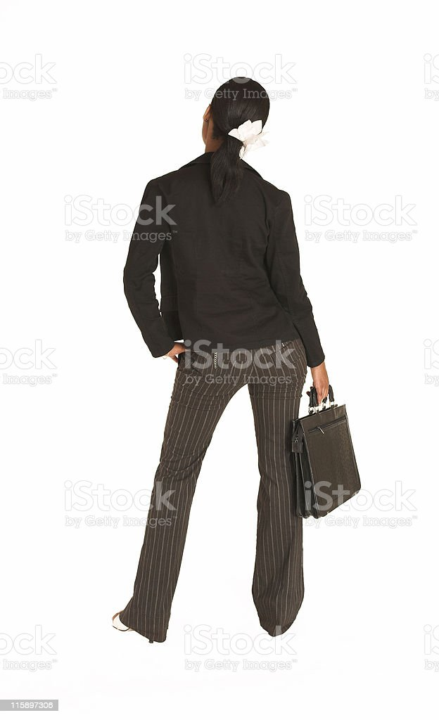 African businesswoman standing with her back to the viewer royalty-free stock photo