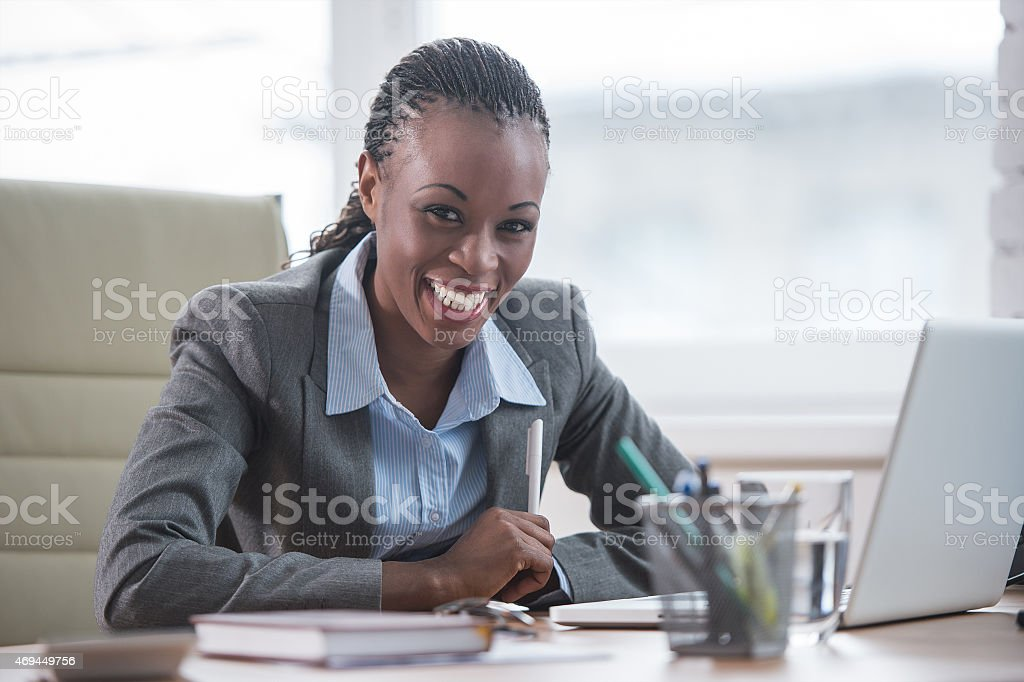 African businesswoman working with laptop stock photo