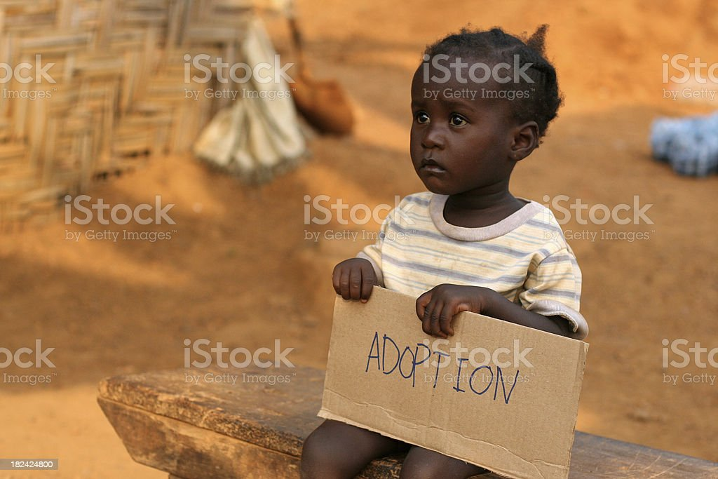 African Child Holding Adoption Sign royalty-free stock photo