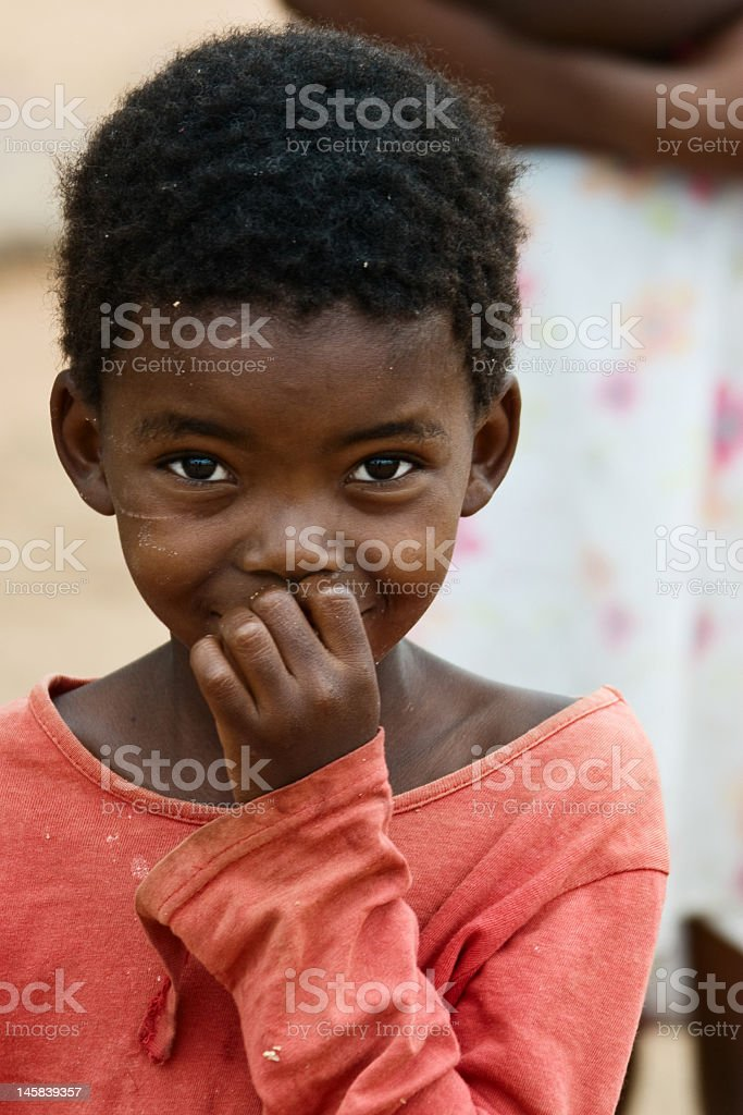 African child in a coral red shirt royalty-free stock photo