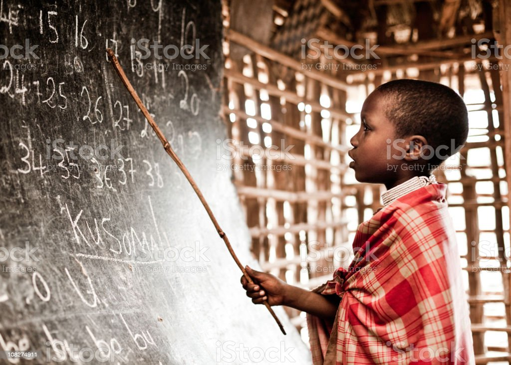 African Child Learning Numbers at School stock photo