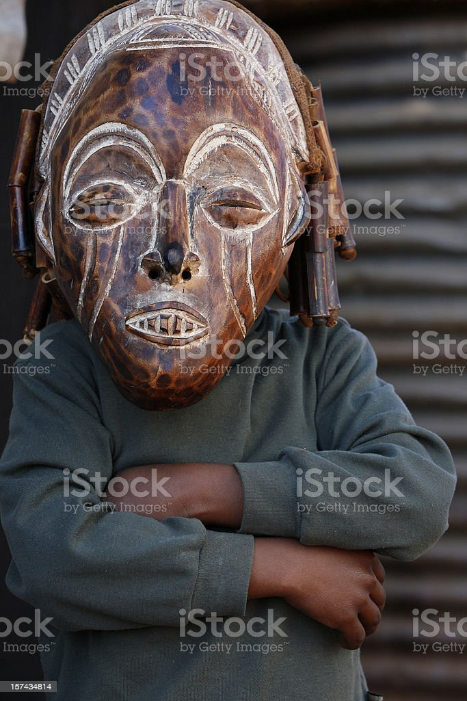 African child wearing tribal mask royalty-free stock photo