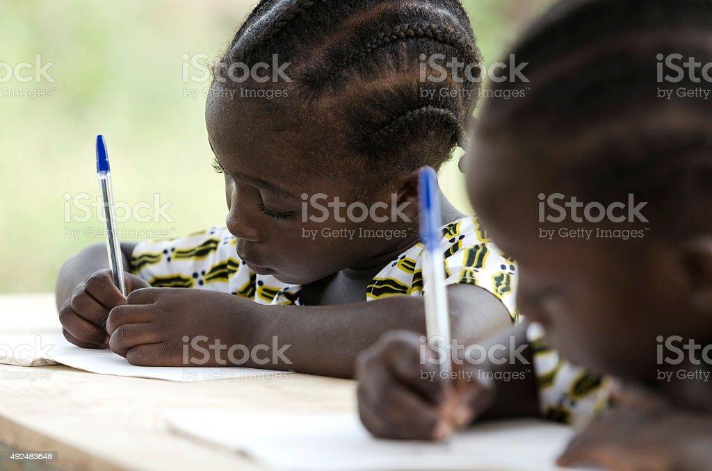 African Children at School Doing Homework stock photo