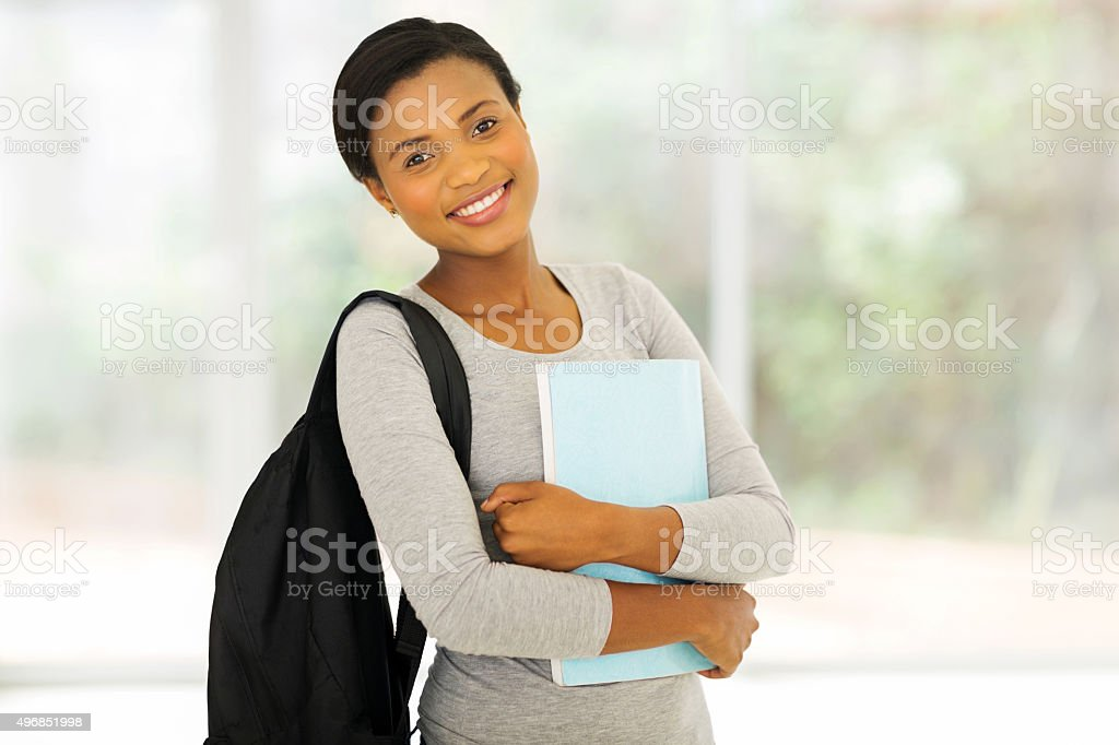 african college student holding a book stock photo