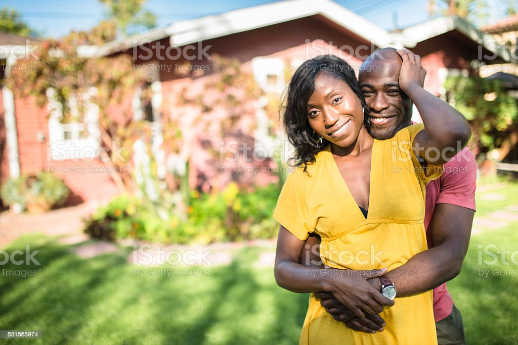 african couple enjoy in the house courtyard stock photo