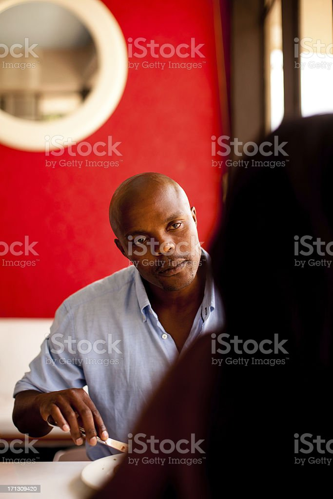 African couple having a serious relationship conversation royalty-free stock photo