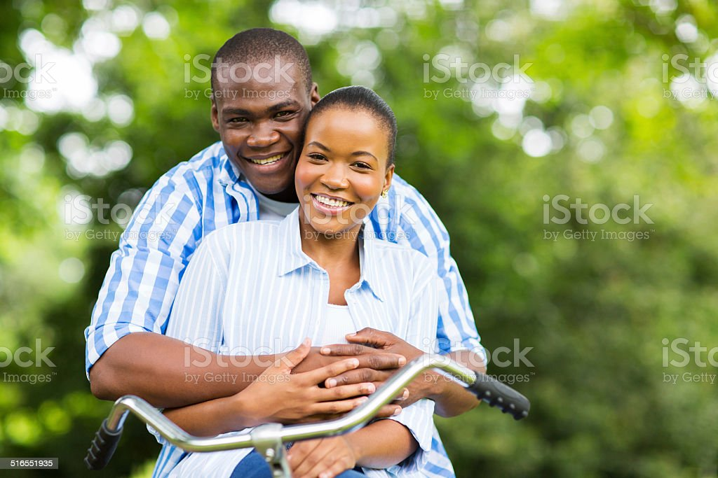 african couple relaxing in forest stock photo