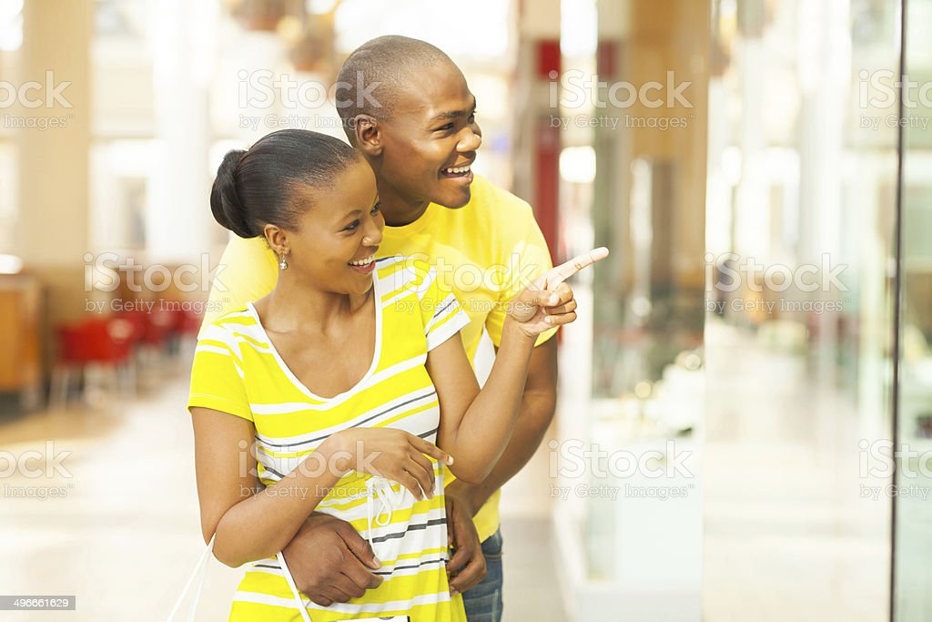 african couple shopping in mall royalty-free stock photo