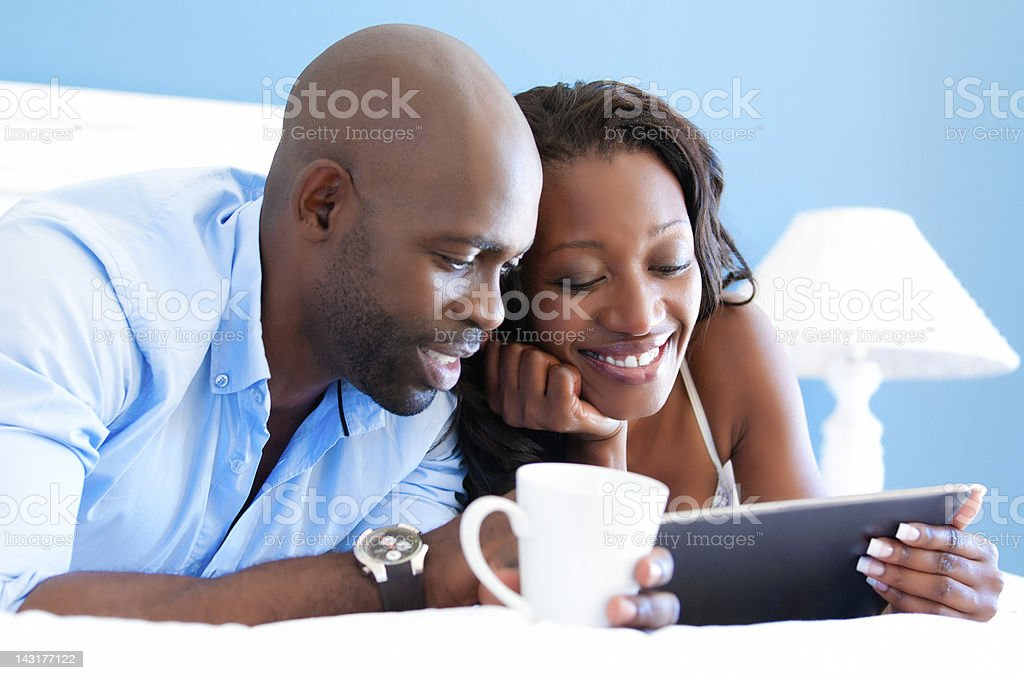 African couple using digital tablet royalty-free stock photo