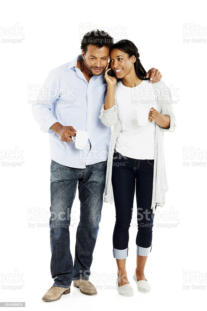 African couple using mobile phone on white royalty-free stock photo