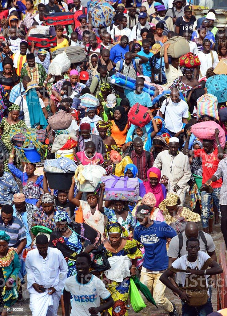 African crowd, Banjul Ferry Terminal, Gambia stock photo