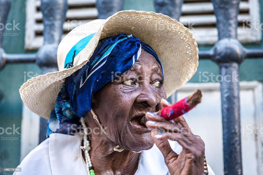 African cuban woman smoking cigar stock photo